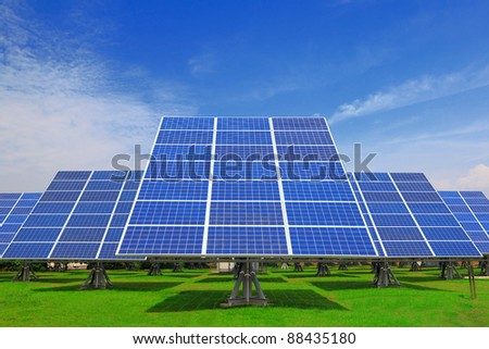 Solar Panel with green grass and beautiful blue sky - stock photo