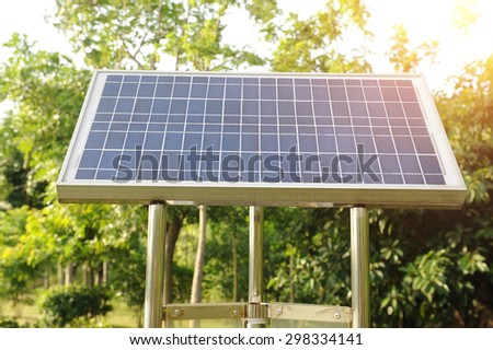 solar panel with green tree - stock photo