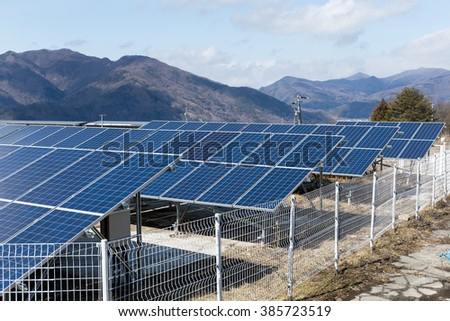 Solar panel with mountain range background