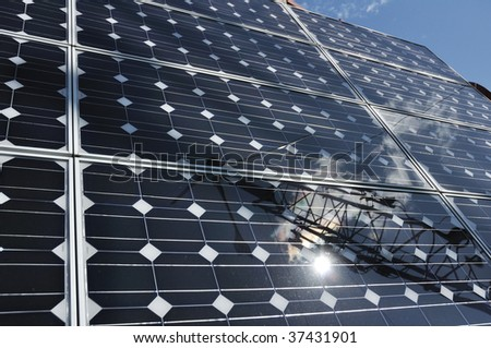 Solar Panel with Reflection of Wind Turbine and Sun