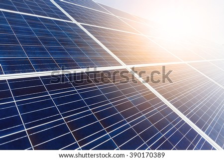 Solar panel with sun beam - stock photo