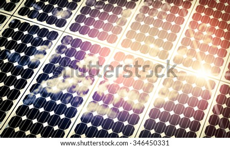 Solar panels absorbing the suns energy on hot summer day - stock photo