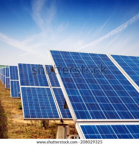 Solar panels against blue sky - stock photo