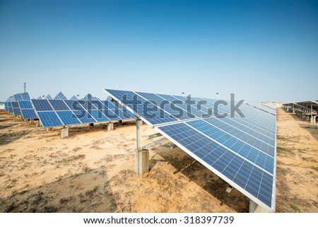 Solar panels against blue sky - stock photo