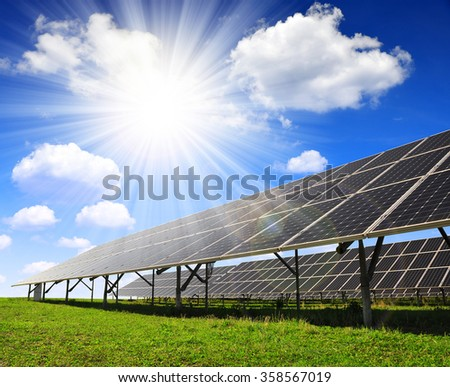 Solar panels against sunny sky. Clean energy. - stock photo