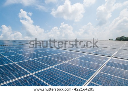 Solar Panels Against The Deep Blue Sky And Clouds. copy space