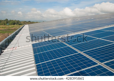 Solar Panels Against The Deep Blue Sky And Clouds. copy space for text - stock photo