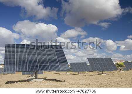 Solar panels aligned and faced to the sunlight at a ecology park (Blue and alternative energy) - stock photo
