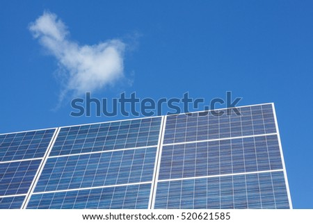 Solar panels and clouds against blue sky