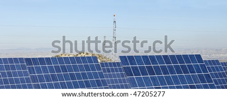 solar panels and power line under clear skies - stock photo