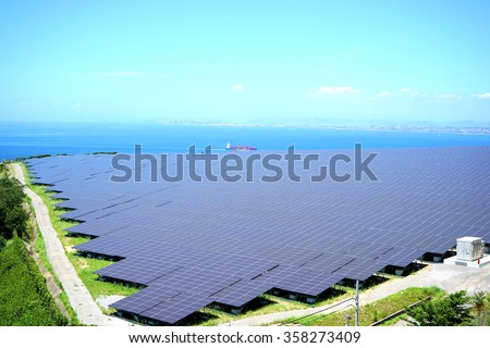Solar panels and wind generators in Large Photovoltaic power station (solar park) - stock photo