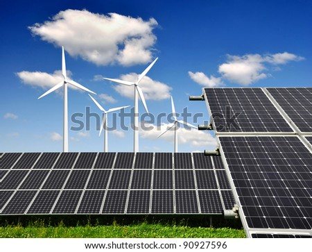 solar panels and wind turbine - stock photo