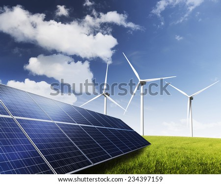 Solar Panels and wind turbines generating green energy. - stock photo