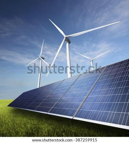 Solar Panels and Wind Turbines in a green field.
