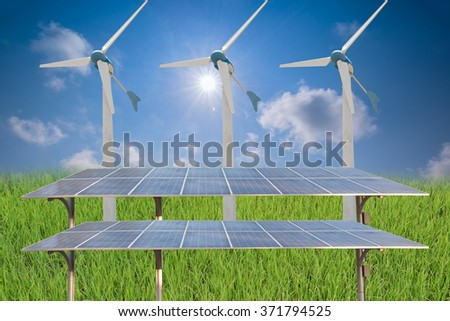 solar panels and wind turbines under blue sky - stock photo