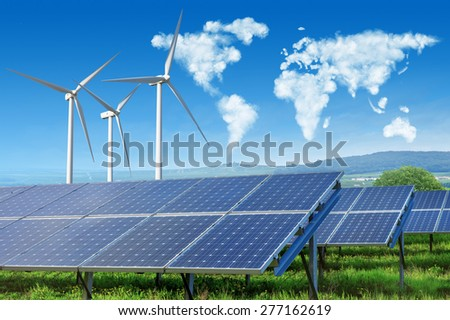 solar panels and wind turbines under blue sky with world map made of clouds - stock photo