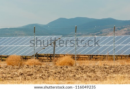 Solar panels at the foot of the mountain