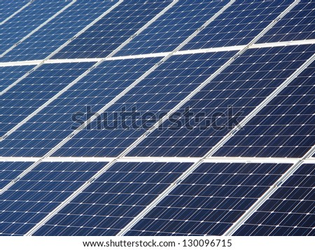 Solar panels background. Photovoltaic renewable energy source. - stock photo