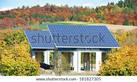Solar panels buildings for sun energy accumulation in the field - stock photo