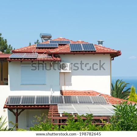 Solar panels covering a house roof