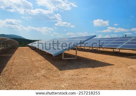 Solar panels for sun energy in landscape - stock photo