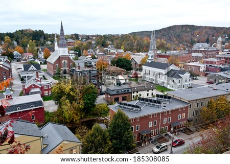 Solar panels grace the roof of an apartment building in this autumn cityscape view of Montpelier, Vermont's state capital. - stock photo