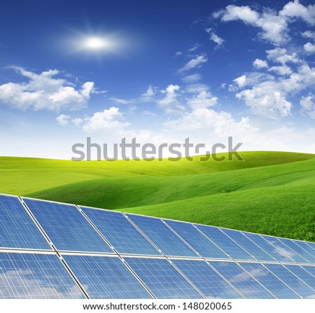 solar panels in a meadow - stock photo