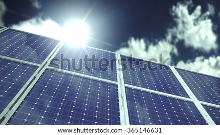 Solar panels in front of blue sky with clouds in sunlight - stock photo