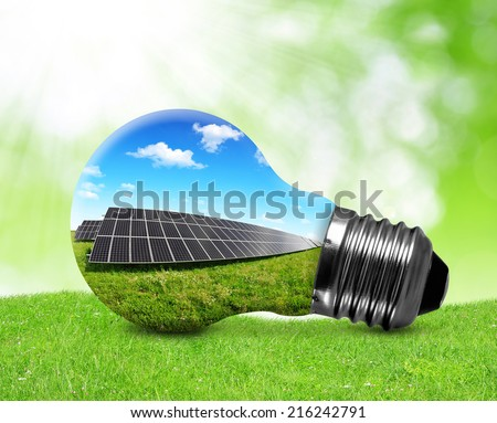 Solar panels in light bulb. Green energy concept. - stock photo