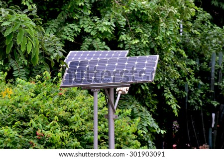 Solar panels in the garden. Geometric lines, shapes and patterns. - stock photo
