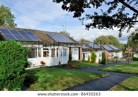 Solar panels installed on domestic roof - stock photo