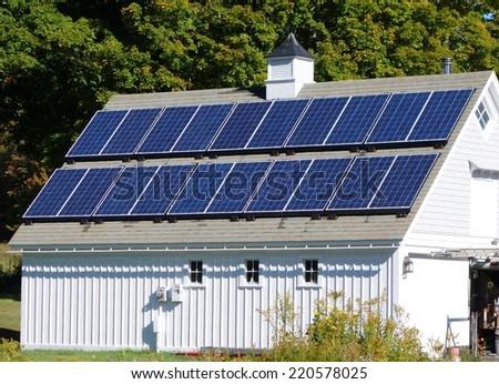 solar panels on a barn roof - stock photo