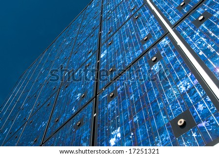 Solar panels on a building against blue sky. - stock photo