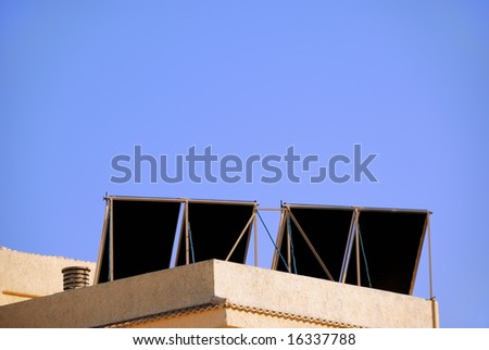 Solar panels on a building in spain and copy-space - stock photo
