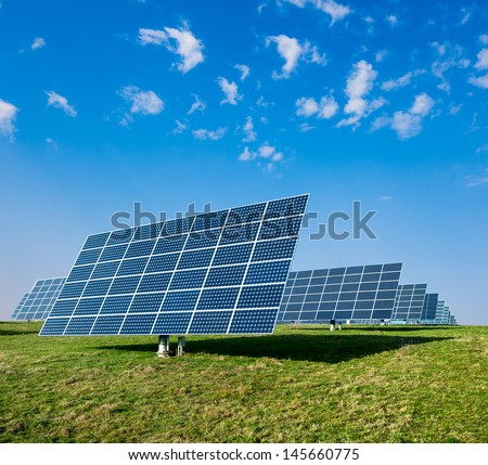 Solar panels on a field - stock photo