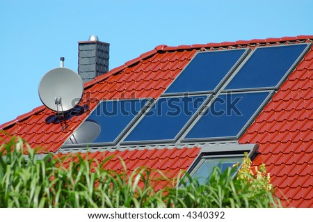 Solar panels on a new roof - stock photo