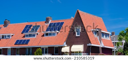 solar panels on a red roof in utrecht, netherlands - stock photo
