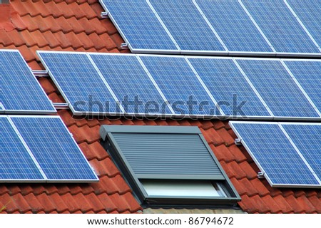 Solar panels on a red roofing tile