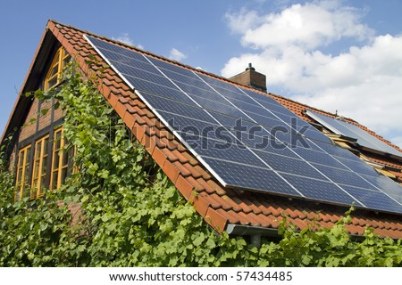 solar panels on a roof of a home - stock photo