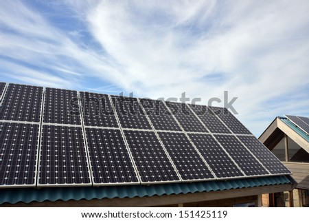 Solar panels on a roof of a house. - stock photo