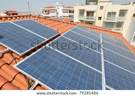 solar panels on a rooftop of a house - stock photo