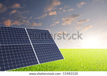 Solar panels on grass field with nice sky in back