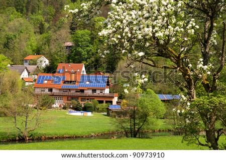 Solar panels on house and barns of privately owned farm in Frankonian Switzerland, Bavaria, Germany - stock photo