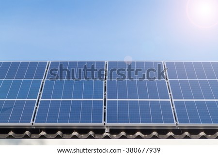 Solar panels on house, lens flare effect
