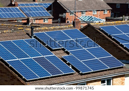 Solar Panels on many residential roofs in the UK - stock photo