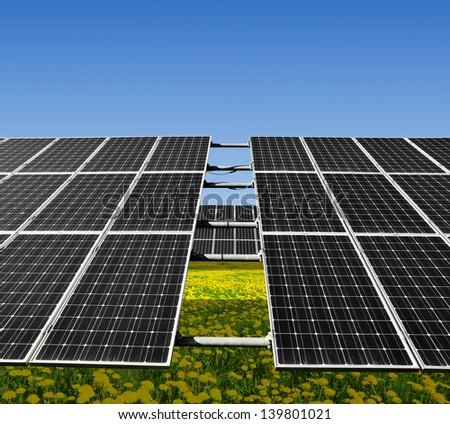 Solar panels on meadow - stock photo