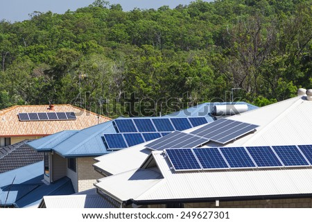 Solar panels on multiple energy efficient homes - stock photo