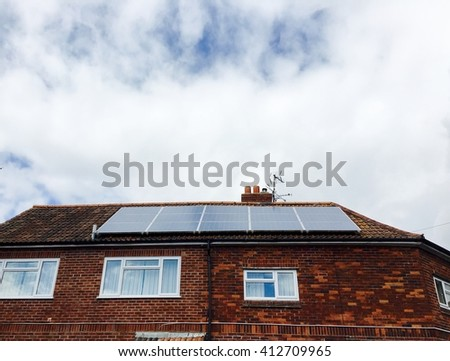 Solar Panels on roof of a house, conceptual image of environmental friendly power generation - stock photo