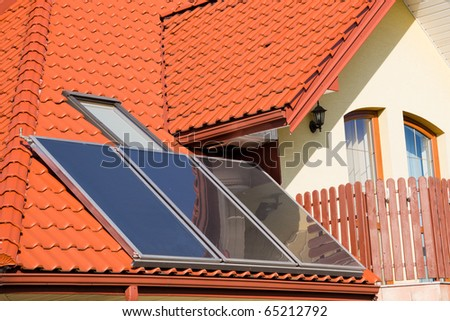 Solar panels on roof of modern family house - stock photo