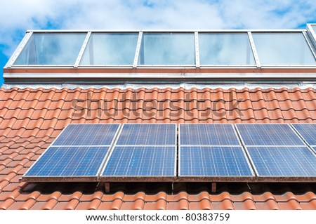 solar panels on roof of the Nordhorn Zoo in Germany - stock photo